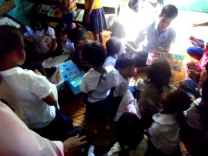 A busy break-time in our library stocked with English and Khmer children's books.