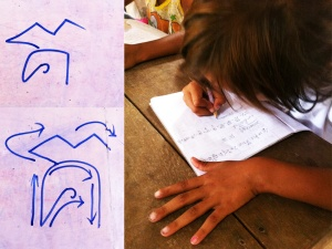 One of our kindergarten students practices writing  her native Khmer at Iqbal school.